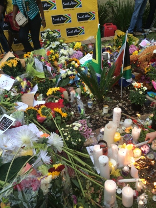 The sea of flowers and candles at Mandela's house